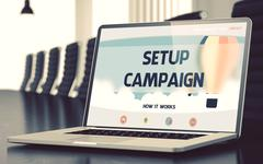 Setup Campaign on Laptop in Conference Hall Stock Illustration
