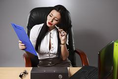 Adult young pretty business woman working at her office Stock Photos
