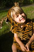 Boy dressed up as tiger - stock photo