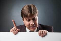 Businessman with index finger up Stock Photos