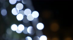Tilting Christmas eve background white dot lights blinking out of focus 4K 21 Stock Footage