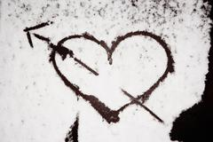 Heart painted in snow - stock photo