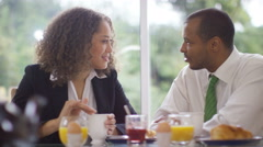 4K Attractive couple chatting & laughing at breakfast before going to work Stock Footage