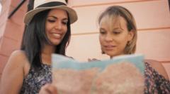 4-Women Travelling In Havana Cuba Reading Map In Calle Obispo Stock Footage