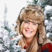Woman with a faux-fur hat, smiling - stock photo