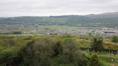 Panoramic view of Stirling Scotland UK with the countryside and town pan Stock Footage