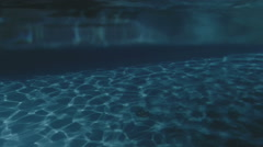 Above and Under Swimming Pool Water - 25FPS PAL Stock Footage