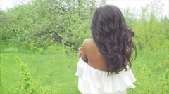 A beautiful dark-skinned woman in a white dress Stock Footage