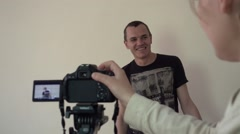 Candidate actor is interviewed in front of camera - stock footage