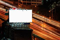White billboard stand on road side at night time Stock Photos