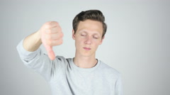 Thumbs Down, Failure, Disagree, Isolated Gesture by Young Man - stock footage