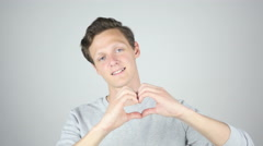 Handmade Heart Sign, Young Man Expressing Love, Isolated Gesture Stock Footage