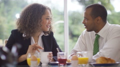 4K Attractive couple chatting & laughing at breakfast before going to work - stock footage