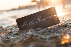 Hello Summer text and sunset on the beach Stock Photos