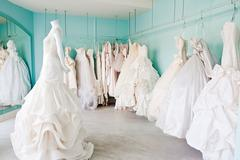 Selection of wedding dresses in boutique Stock Photos