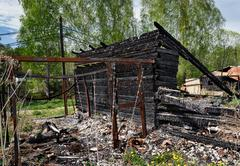 Remains of burned down house - stock photo