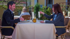 Taking napkins and folding them beside their plates Stock Footage