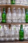 Empty bottles of Coca-Cola and Sprite on shelves Stock Photos