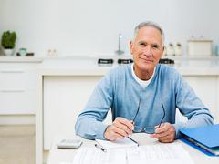 Senior man doing home finances Stock Photos