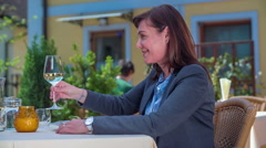 Drinking white wine out of the glass - stock footage