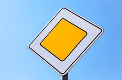 Traffic signs main road against the blue sky background Stock Photos