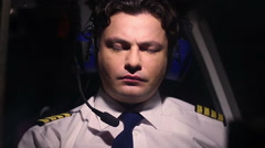 Overworked pilot feeling unwell during flight, suffer headache, accident risk Stock Footage