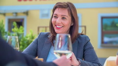 Drinking a sip of a delicious white wine - stock footage