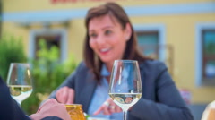 Stop cutting their food and toasting with white wine - stock footage