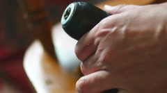 The man inserts a drill bit in an electric drill close-up shot Stock Footage