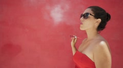 11-Slowmotion Woman In Red Clothes Smokes Electronic Cigarette E-Cig Stock Footage