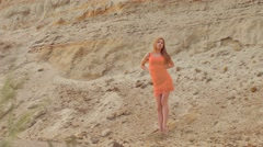 sexy girl on the background of the sandy slope - stock footage