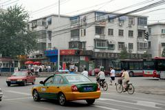 Mid-afternoon street traffic in Beijing, China.FTP - stock photo