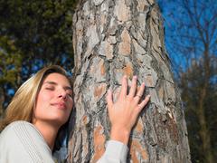 Woman hugging a tree Stock Photos