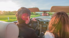 Driving in an open rood red car - stock footage