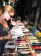 Woman reading a book, in a bookstore Stock Photos
