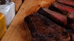Beef fillet steak on fork over wooden board Stock Footage