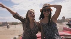 14-Slowmotion Happy Tourist Girls On Vintage Car Havana Cuba Stock Footage