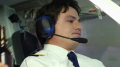 Crazy male pilot accepting proposal to drink beer during flight, taking bottle Stock Footage
