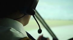 Civil aviation pilot using radio for communication with air traffic controller Stock Footage
