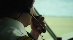 Happy pilot talking to controller, navigating airliner while moving on runway Stock Footage