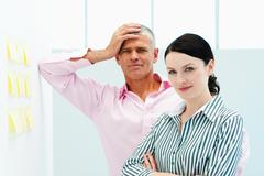 Male and female business colleagues - stock photo