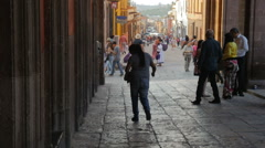 Tourists walk around the closed streets of San Miguel de Allende in slow mo Stock Footage