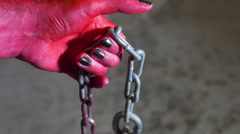 devil hand with hook chain satan hell - stock footage