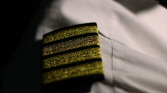 Aircrew captain at work, closeup of pilot's shirt epaulets, career in aviation Stock Footage