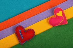 Craft and art two felt hearts on stripes - stock photo
