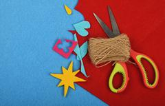 Craft and art felt cuts, twine and scissors Stock Photos