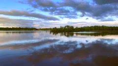 Dark sky reflected in calm the waters, gliding low, aerial view Stock Footage