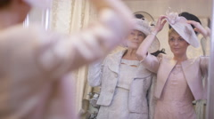 4K Portrait of 2 mature ladies shopping for outfits for a special event - stock footage
