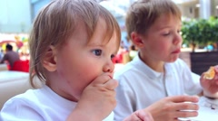 The children eat in a fast food restaurant Stock Footage