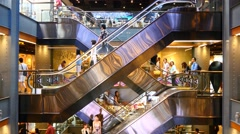 Escalator 4k shopping mall crowd people shop center centre sale shops time lapse Stock Footage